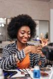 Beautiful dark-skinned african american woman feeling happy stock image