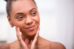 Beautiful dark skinned girl stock image