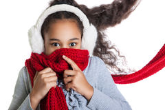 A beautiful dark-skinned girl in a red scarf. Cold. Royalty Free Stock Images
