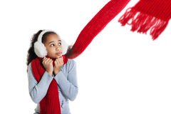 A beautiful dark-skinned girl in a red scarf. Cold. Royalty Free Stock Photography