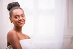 Beautiful  dark skinned girl in white towel Royalty Free Stock Photography