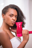 Beautiful dark skinned girl in white towel royalty free stock photo