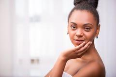 Beautiful  dark skinned girl in white towel Stock Images