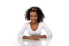A beautiful dark-skinned woman in a white dress Royalty Free Stock Photo