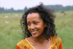 Beautiful dark woman smiling. Pretty dark woman in dutch meadow Royalty Free Stock Photo