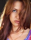Beautiful darkhaired women isolated on black Stock Image