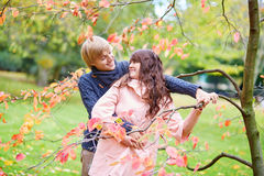 Beautiful dating couple in park on a fall day Royalty Free Stock Images
