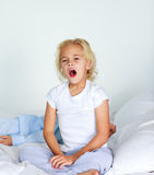Beautiful daughter yawning in bed Royalty Free Stock Photos