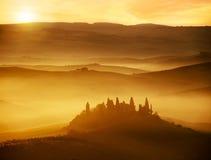 Beautiful dawn on foggy hills stock photos