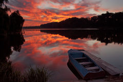 Beautiful dawn at the lake. With a boat Royalty Free Stock Photo