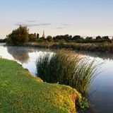 Beautiful dawn landscape image of River Thames at Lechlade-on-Th. Beautiful sunrise landscape image of River Thames at Lechlade-on-Thames in English Cotswolds Royalty Free Stock Photos