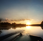 Beautiful dawn morning in an inflatable boat with Royalty Free Stock Image