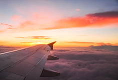 Beautiful dawn with orange and pink clouds. View from the plane. Royalty Free Stock Photography