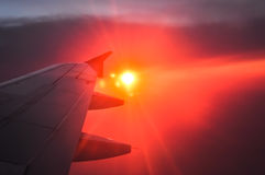 Beautiful dawn with orange and pink clouds. View from the plane. Royalty Free Stock Photos