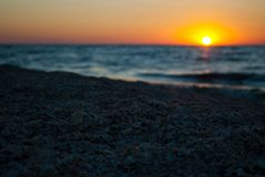 Beautiful dawn, red sun, purple pink sky, clear sky, sunrise over the sea, blue sea, waves Royalty Free Stock Photos