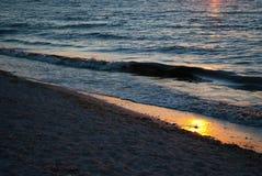 Beautiful dawn, red sun, purple pink sky, Clear sky, sunrise over the sea, blue sea waves, sunny path Royalty Free Stock Photo