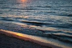 Beautiful dawn, red sun, purple pink sky, Clear sky, sunrise over the sea, blue sea waves, sunny path Stock Image