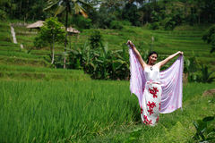 Beautiful Day. Asian woman with her sarong at rice field Stock Photos