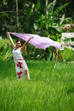 Beautiful Day. Asian woman with her sarong at rice field Royalty Free Stock Photo