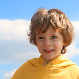Beautiful day. Boy enjoying a bright and sunny day Stock Photography
