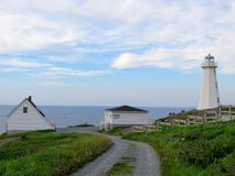 Beautiful day along the coast of Newfoundland viewing the lighthouse on Cape Spear royalty free stock images