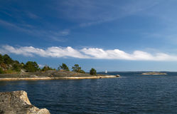 Beautiful day in the archipelago. Fluffy white clouds over the islands in Stockholm archipelago stock images