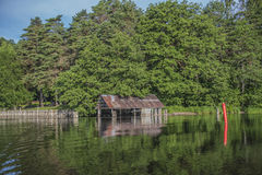 A beautiful day in a boat at five sea, old boathouse Royalty Free Stock Photo