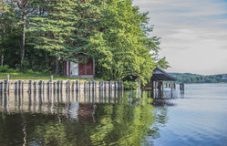 A beautiful day in a boat at five sea, old cottage and boathouse Royalty Free Stock Photos
