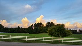 Beautiful day. Fenced property with bright sunny skies Royalty Free Stock Photo