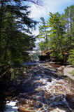 Beautiful Day. A flowing streams end at lake superior up in the UP OF Mich. on a nice sunny day Stock Photography
