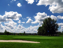 A beautiful day for Golf. The green and sand trap of a golf course on a gorgeous summer day Stock Photo