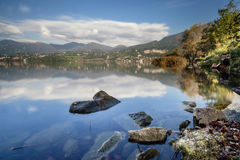 A beautiful day at the lake. North Italy landscape with rocks and reflections stock images