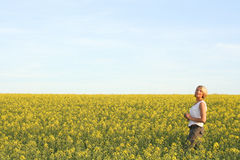 Beautiful Day - Summer time. A beautiful young woman and yellow flowers Royalty Free Stock Photo