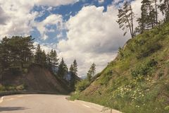 Beautiful daytime landscape with mountain road and amazing cloudy sky. Beautiful day time landscape with mountain road and amazing cloudy sky. Pass through the stock photography