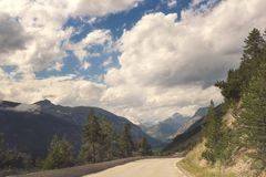 Beautiful daytime landscape with mountain road and amazing cloudy sky. Beautiful day time landscape with mountain road and amazing cloudy sky. Pass through the royalty free stock photography