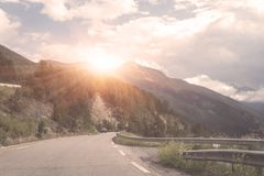 Beautiful daytime landscape with mountain road and amazing cloudy sky. Beautiful day time landscape with mountain road and amazing cloudy sky. Pass through the royalty free stock image