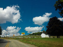 Beautiful day. To drive through the country and see cemetery's with beautiful cumulus clouds Stock Photos
