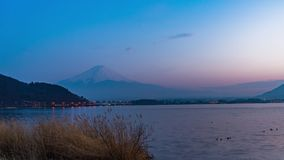 Beautiful Day to Night View of Mount Fuji at kawaguchiko, Japan in the sunny day with moving cloud. Lake kawaguchi is a very popular for tourists and stock video