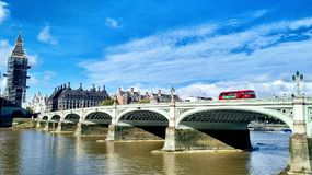 London cityscape with Big Ben, Westminster Bridge, and classic double-decker. royalty free stock images