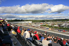 Beautiful day for a truck race. Fans take in the 2007 Fall NASCAR Truck Race at New Hampshire International Speedway Stock Photo