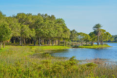 A beautiful day for a walk and the view of the wood bridge to the island at John S. Taylor Park in Largo, Florida. stock photography