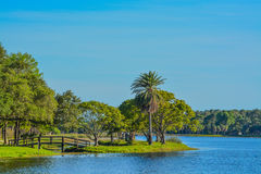 A beautiful day for a walk and the view of the wood bridge to the island at John S. Taylor Park in Largo, Florida. The view of the wood bridge to the island at stock photography