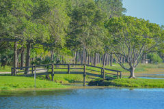 A beautiful day for a walk and the view of the wood bridge to the island at John S. Taylor Park in Largo, Florida. The view of the wood bridge to the island at stock photos