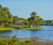 A beautiful day for a walk and the view of the wood bridge to the island at John S. Taylor Park in Largo, Florida. The view of the wood bridge to the island at royalty free stock images