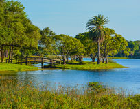 A beautiful day for a walk and the view of the wood bridge to the island at John S. Taylor Park in Largo, Florida. royalty free stock photography