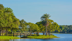 A beautiful day for a walk and the view of the wood bridge to the island at John S. Taylor Park in Largo, Florida. stock photos