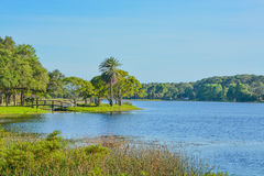 A beautiful day for a walk and the view of the wood bridge to the island at John S. Taylor Park in Largo, Florida. The view of the wood bridge to the island at Stock Image