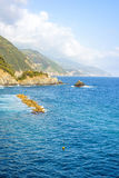 Beautiful daylight view to blue sea and green mountains Royalty Free Stock Photos