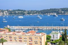 Beautiful daylight view to boats and ships on water in Villefranche-sur-Mer Stock Images
