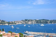 Beautiful daylight view to boats and ships on water in Villefranche-sur-Mer Royalty Free Stock Images